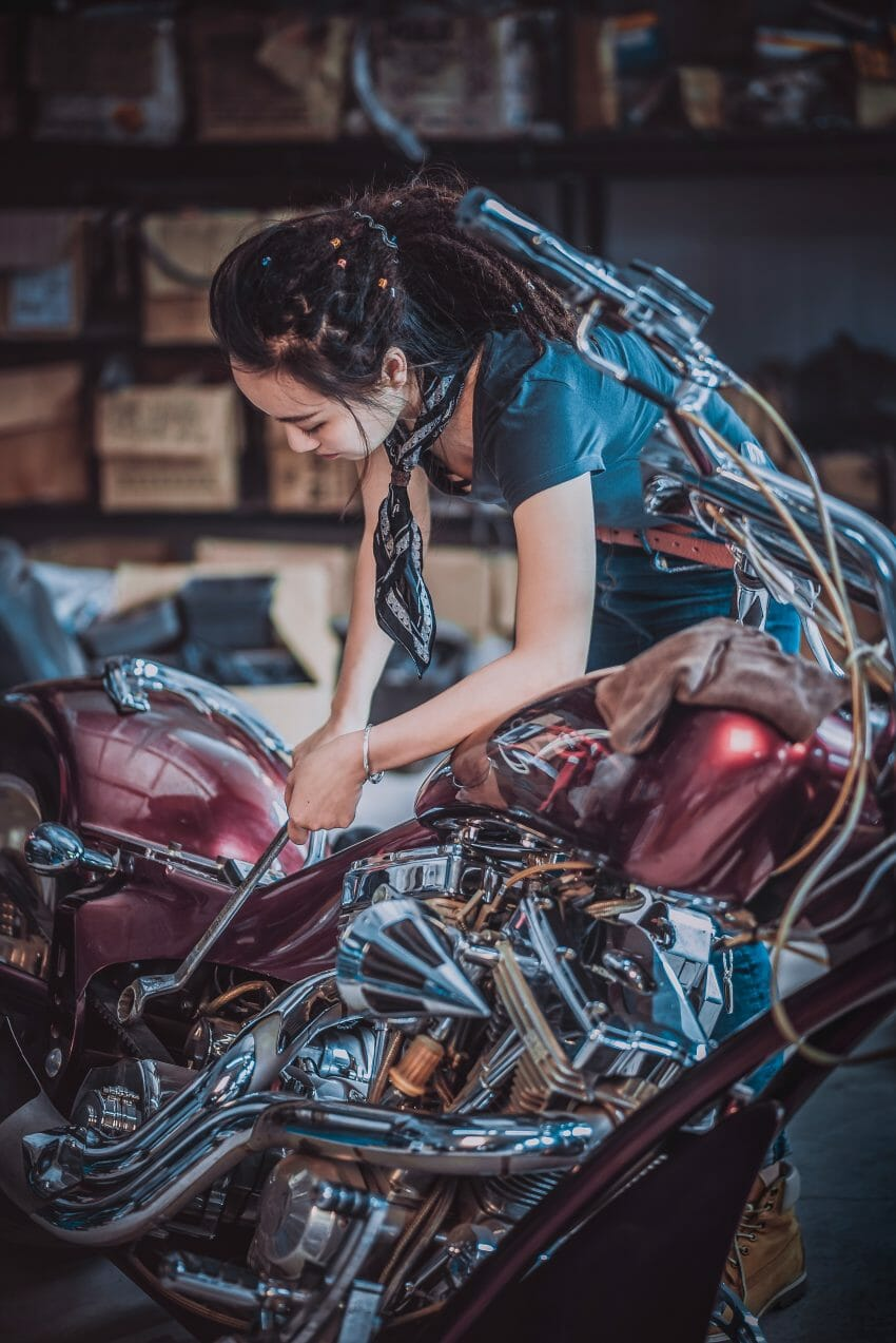 woman adjusting motorcycle reasonable adjustment equalities act 2010 diversity inclusion AbilityNet